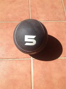 An exercise for balance with medicine ball